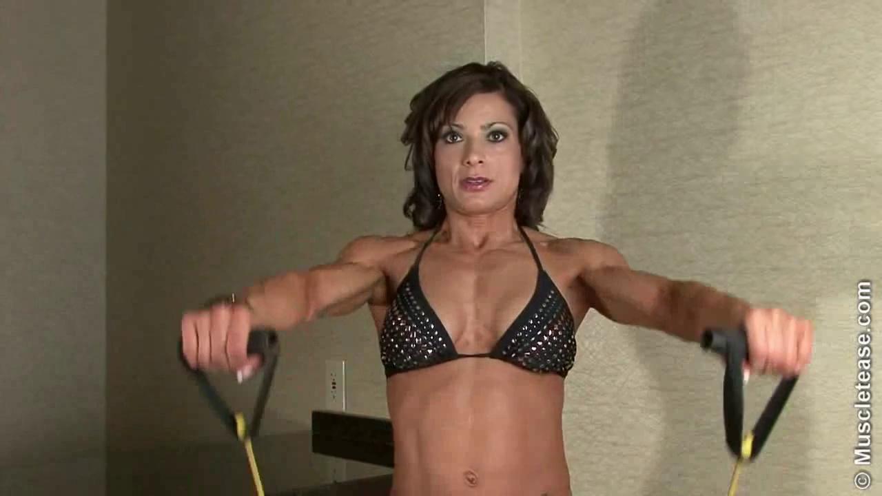 Latina Girl Pumping Up Biceps
