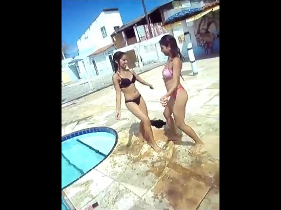 Two Latinas in Bikinis Trying to Dance